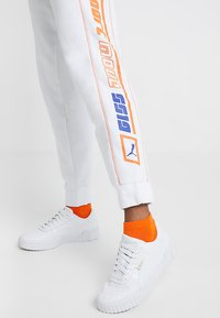 Puma - PANTS - Tracksuit bottoms - white - 3