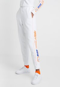 Puma - PANTS - Tracksuit bottoms - white - 0