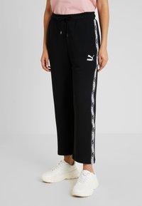 Puma - CLASSICS TAPE PANT - Teplákové kalhoty - black - 0