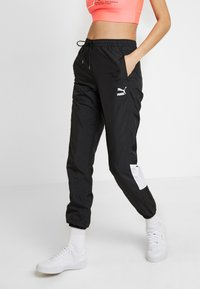 Puma - TRACK PANT - Tracksuit bottoms - black - 0