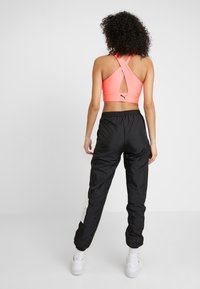 Puma - TRACK PANT - Tracksuit bottoms - black - 2