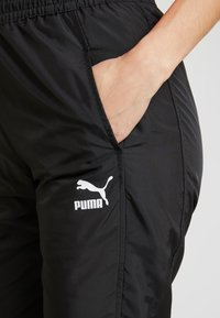 Puma - TRACK PANT - Tracksuit bottoms - black - 4