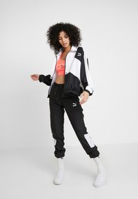 Puma - TRACK PANT - Tracksuit bottoms - black - 1