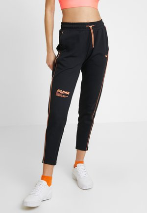 EVIDE PANTS - Tracksuit bottoms - black/orange