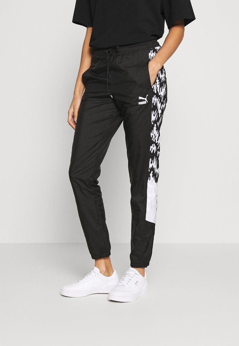 Puma - PANTS - Teplákové kalhoty - black