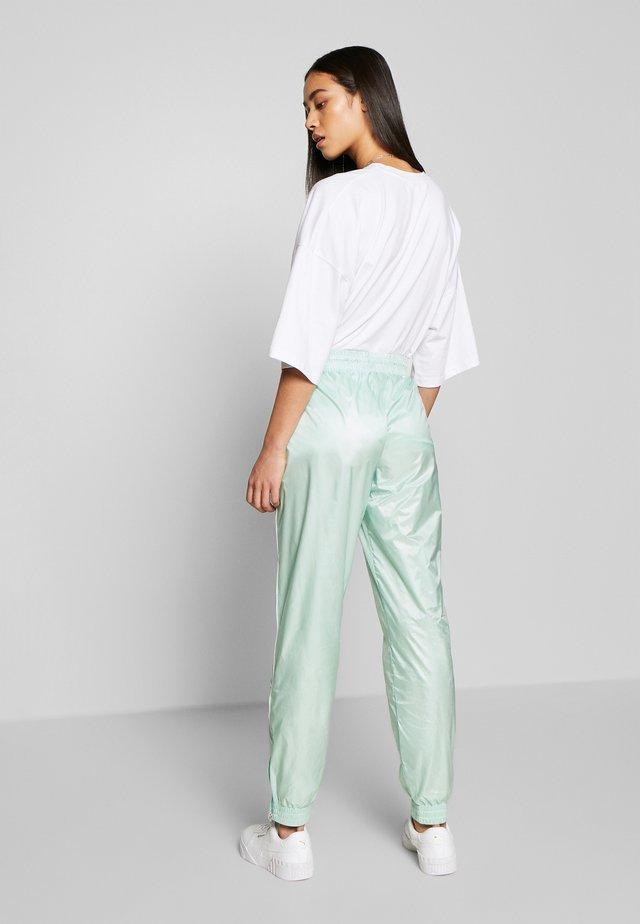EVIDE TRACK PANT - Pantalon de survêtement - mist green