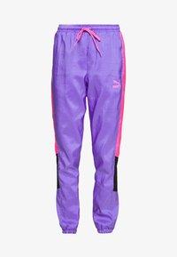 Puma - TFS OG RETRO PANTS - Pantalon de survêtement - luminous purple - 3