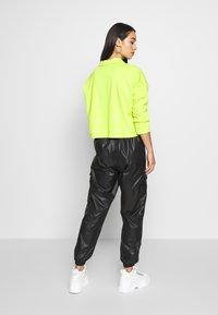 Puma - PANTS - Pantalon de survêtement - black - 2