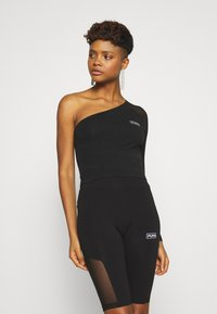 Puma - ASSYMETRIC CROPPED TEE - Long sleeved top - black - 0