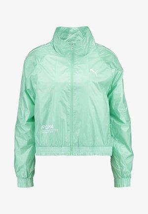 EVIDE JACKET - Waterproof jacket - mist green