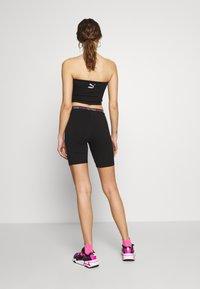 Puma - TIGHT SHORTS - Shorts - black - 2