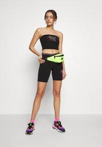 Puma - TIGHT SHORTS - Shorts - black - 1