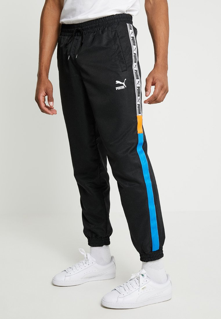 Puma - Tracksuit bottoms - black