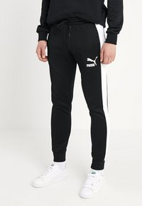 Puma - ICONIC TRACK PANTS - Pantalon de survêtement - black - 0