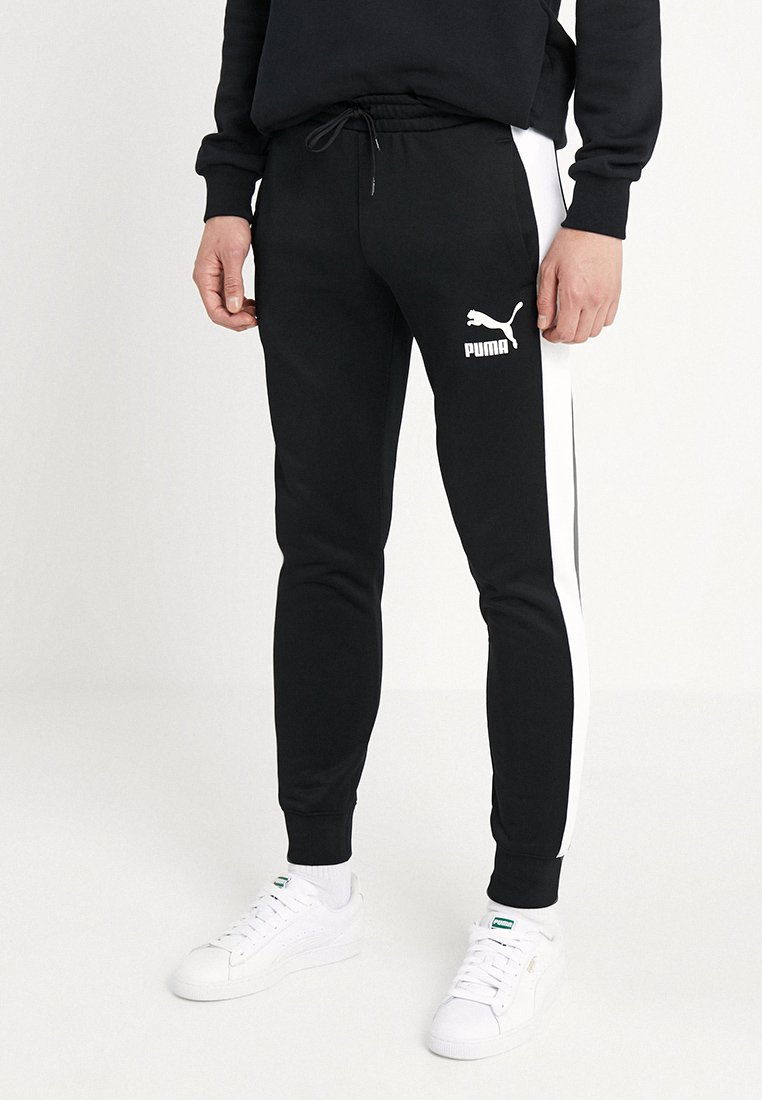 Puma - ICONIC TRACK PANTS - Tracksuit bottoms - black