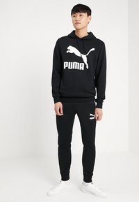 Puma - ICONIC TRACK PANTS - Pantalon de survêtement - black - 1