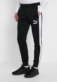 Puma - ICONIC TRACK PANT CUFF - Pantalon de survêtement - black - 0