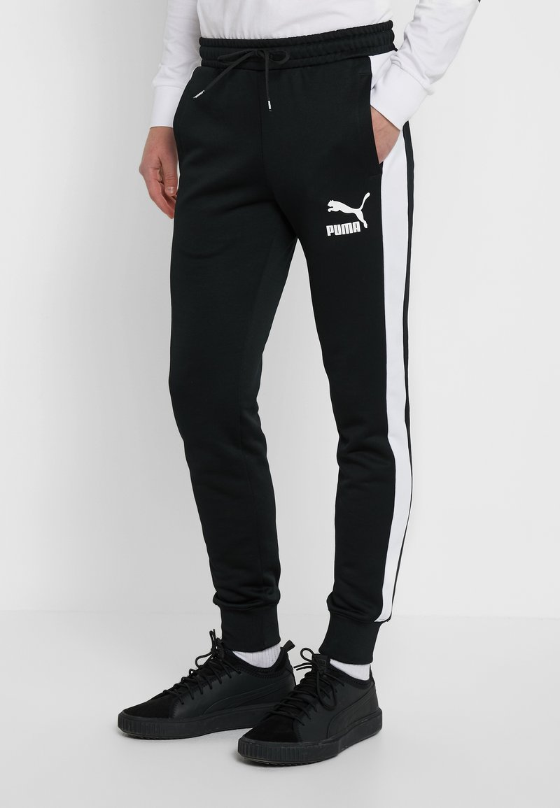 Puma - ICONIC TRACK PANT CUFF - Tracksuit bottoms - black