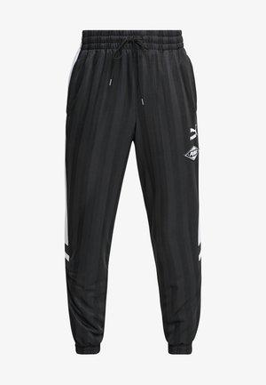 LUXTG WOVEN PANT - Verryttelyhousut - black