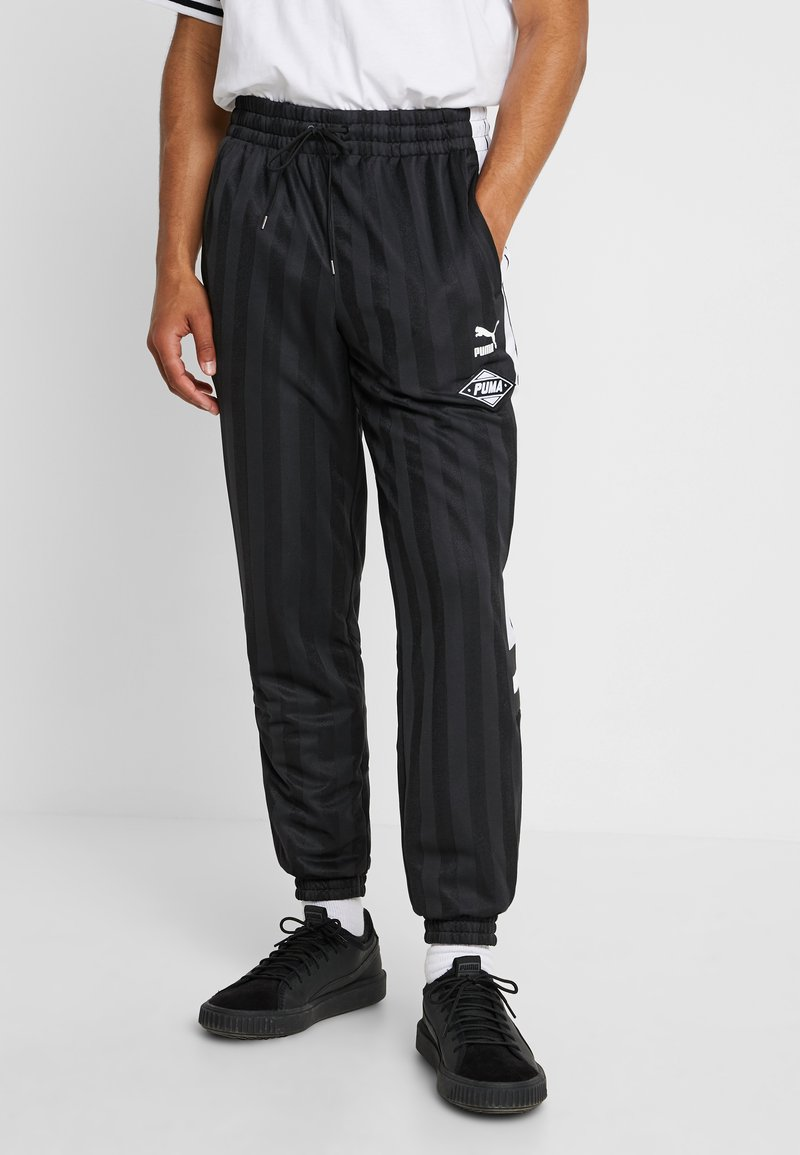 Puma - LUXTG WOVEN PANT - Træningsbukser - black