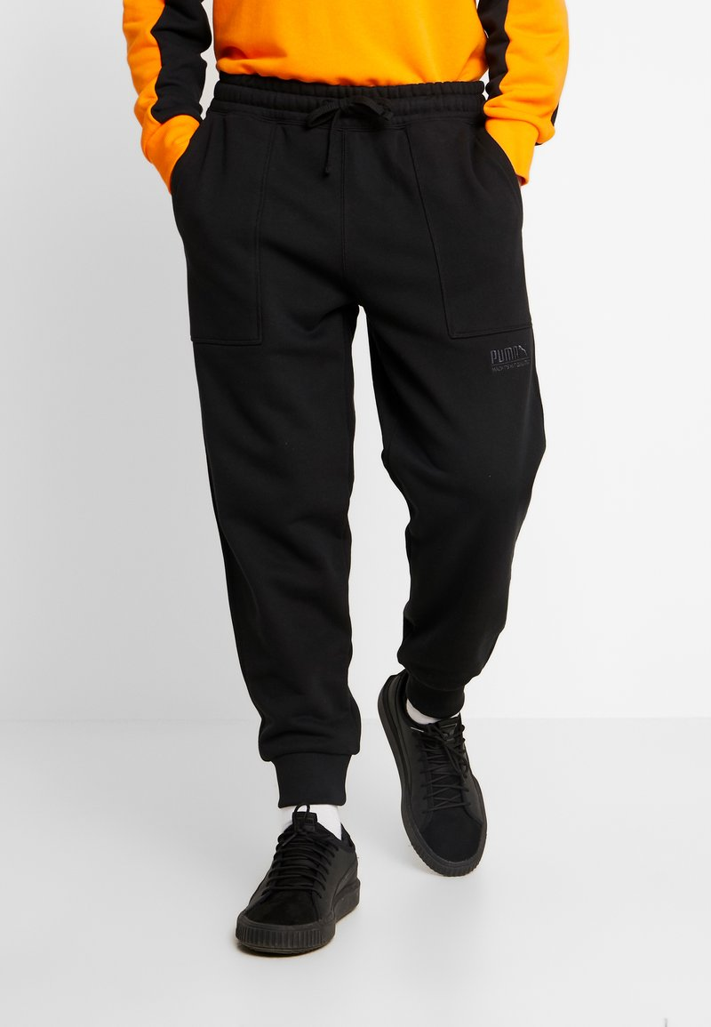 Puma - HEAVY CLASSICS PANTS - Tracksuit bottoms - black