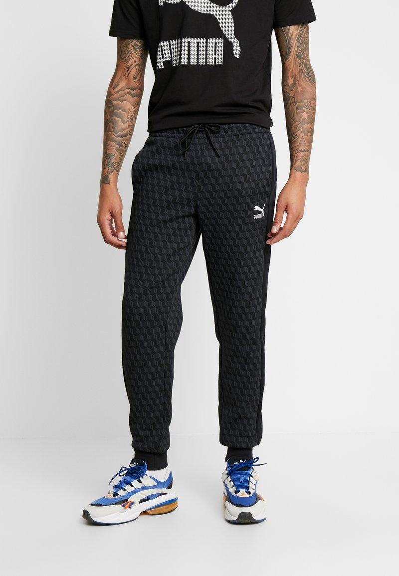 Puma - LUXE PACK TRACK PANTS - Träningsbyxor - black