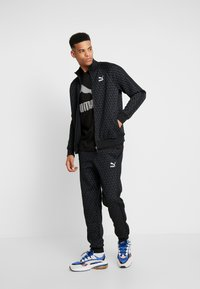 Puma - LUXE PACK TRACK PANTS - Träningsbyxor - black - 1