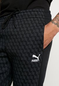 Puma - LUXE PACK TRACK PANTS - Träningsbyxor - black - 5