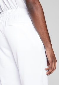 Puma - ICONIC  - Verryttelyhousut - white - 3