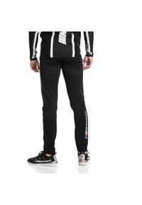 Puma - Pantaloni sportivi -  black - 1