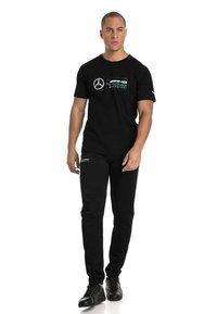 Puma - AMG PETRONAS - T-shirt con stampa - black - 0