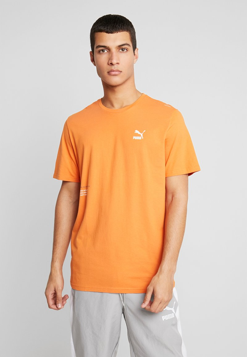 Puma - TRAIL GRAPHIC TEE - Camiseta estampada - jaffa orange