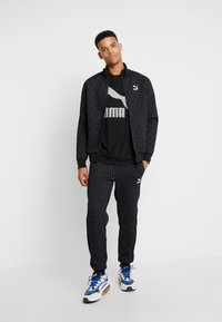Puma - TREND  LOGO TEE - T-shirt con stampa -  black - 1