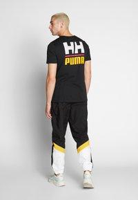 Puma - X HELLY HANSEN TEE - T-shirt imprimé - black - 2