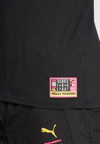 Puma - X HELLY HANSEN TEE - T-shirt imprimé - black - 5