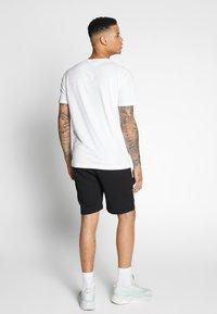 Puma - AMG TEE - Print T-shirt - white - 2