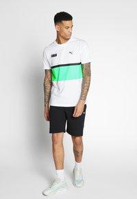 Puma - AMG TEE - Print T-shirt - white - 1