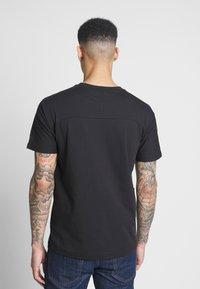 Puma - AMG TEE - Print T-shirt - puma black - 2