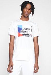 Puma - BMW GRAPHIC TEE - Print T-shirt - puma white - 0