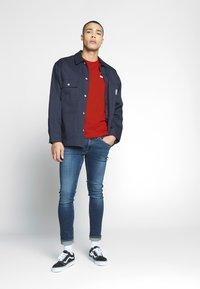 Puma - ICONIC - Print T-shirt - high risk red - 1