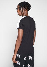 Puma - ICONIC - Print T-shirt - puma black - 2