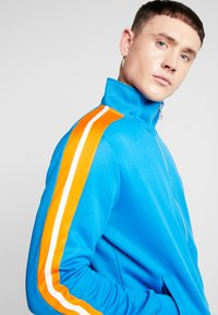 Puma - HOTWHEELS TRACKTOP - Training jacket - blue - 3