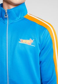 Puma - HOTWHEELS TRACKTOP - Training jacket - blue