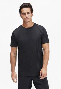Puma - Basic T-shirt - jet black - 0