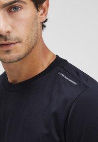 Puma - Basic T-shirt - jet black - 3