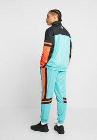 Puma - LUXTG WOVEN JACKET - Veste de survêtement - blue turquoise - 2