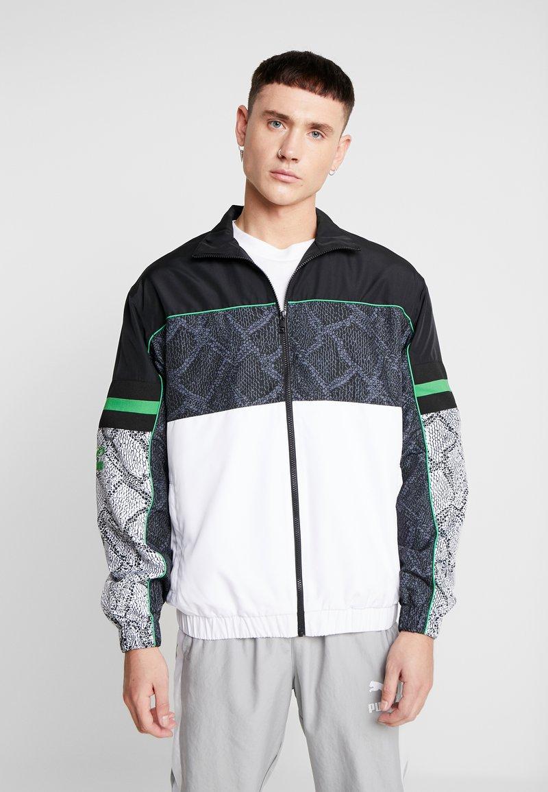 Puma - SNAKE PACK JACKET - Summer jacket - white
