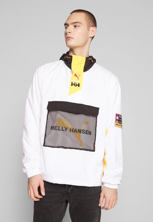 PUMA X HELLY HANSEN WINDBREAKER - Lehká bunda - white