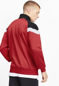 Puma - Veste de survêtement - red - 2