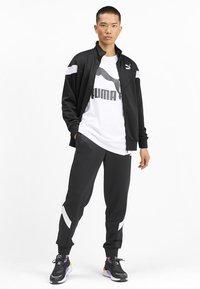 Puma - Veste de survêtement - black - 1